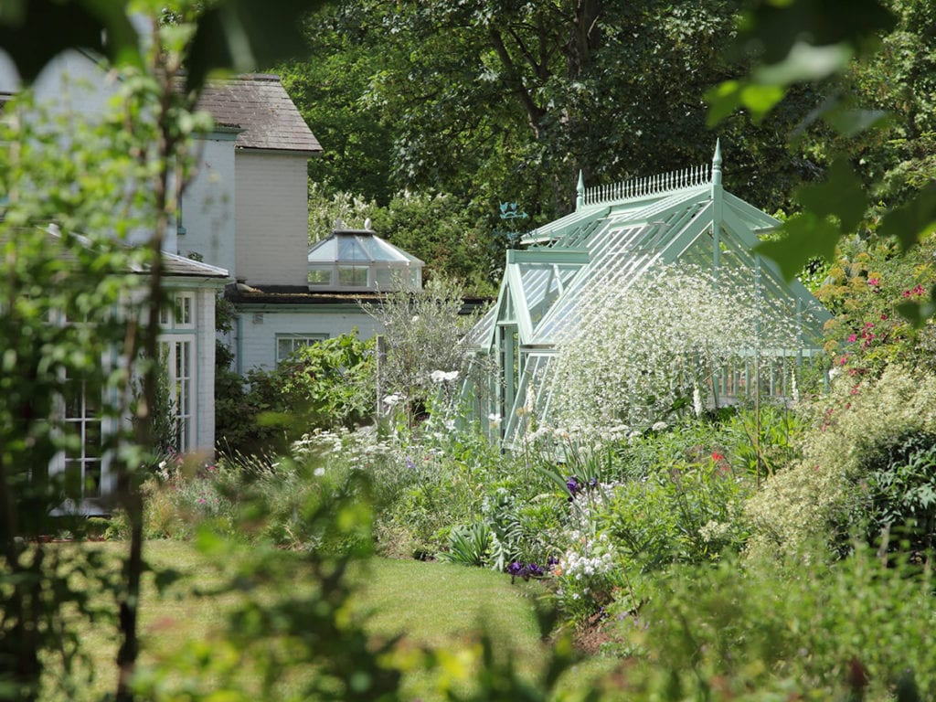Beautiful traditional greenhouse in Surrey garden