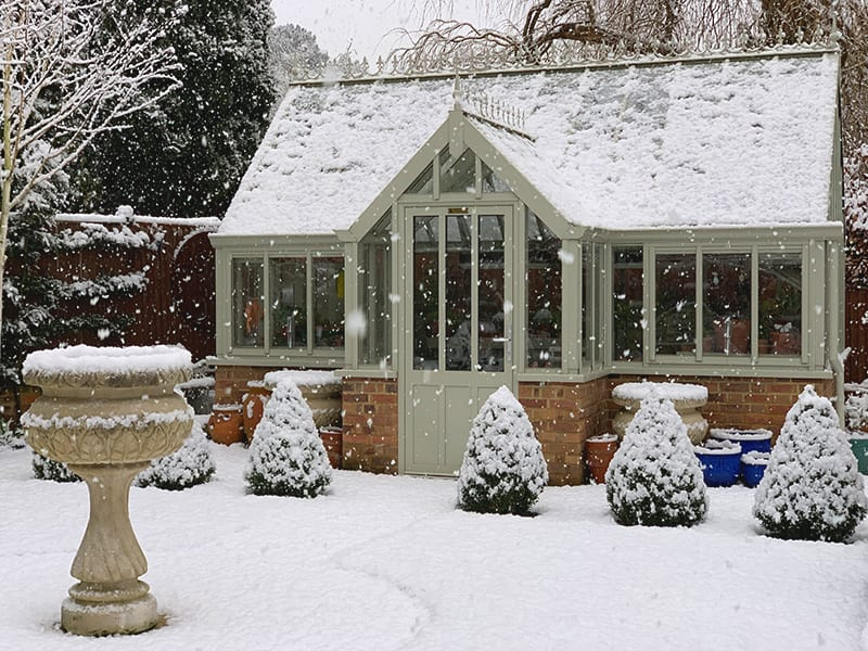 victorian greenhouse in winter